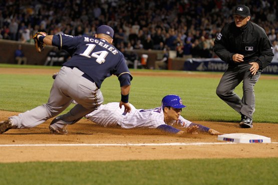 Darwin Barney slides into third on June 13, 2011