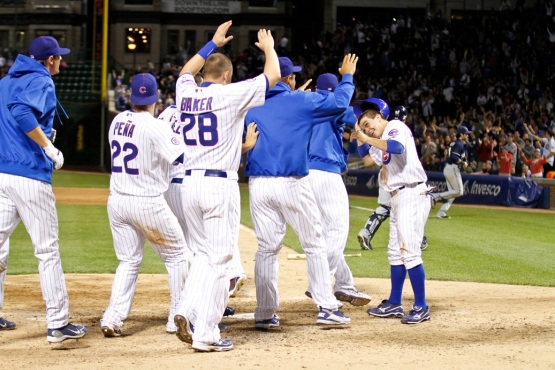 Tony Campana gets mobbed at home plate.