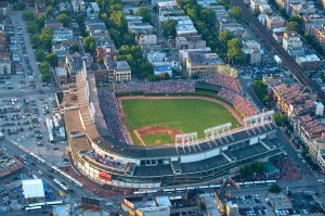 """""""My first thoughts of Wrigley Field are of arriving at the park for an afternoon game. I usually get there at around 9:45 a.m., while it's still empty. The only sounds I hear come from the bustling city surrounding this baseball oasis. It's very peaceful, even with the faint sounds of car horns in the distance. … The dichotomy of a calm, green pasture in the middle of a frantic urban setting is very comforting."""" — Len Kasper, Cubs TV play-by-play announcer"""