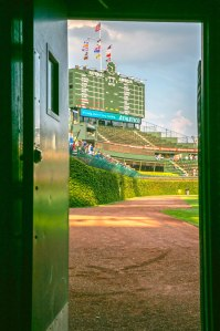 """Sometimes I'll sit out here early in the morning, and I might be the only one on the field. You hear the birds chirping, and you look at the ivy and scoreboard with a cup of coffee, and it's pretty cool."" — Rick Fuhs, Cubs groundskeeper"
